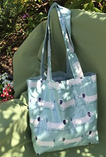 https://sites.google.com/a/handmadebymelinda.co.uk/handmadebymelinda/home/shop/bags/totes/tb0060-cream-birds-with-cages